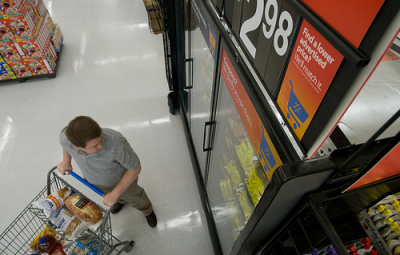 photo credit: Walmart Shopper Selects Frozen Food Items from the New Display Case via photopin (license)